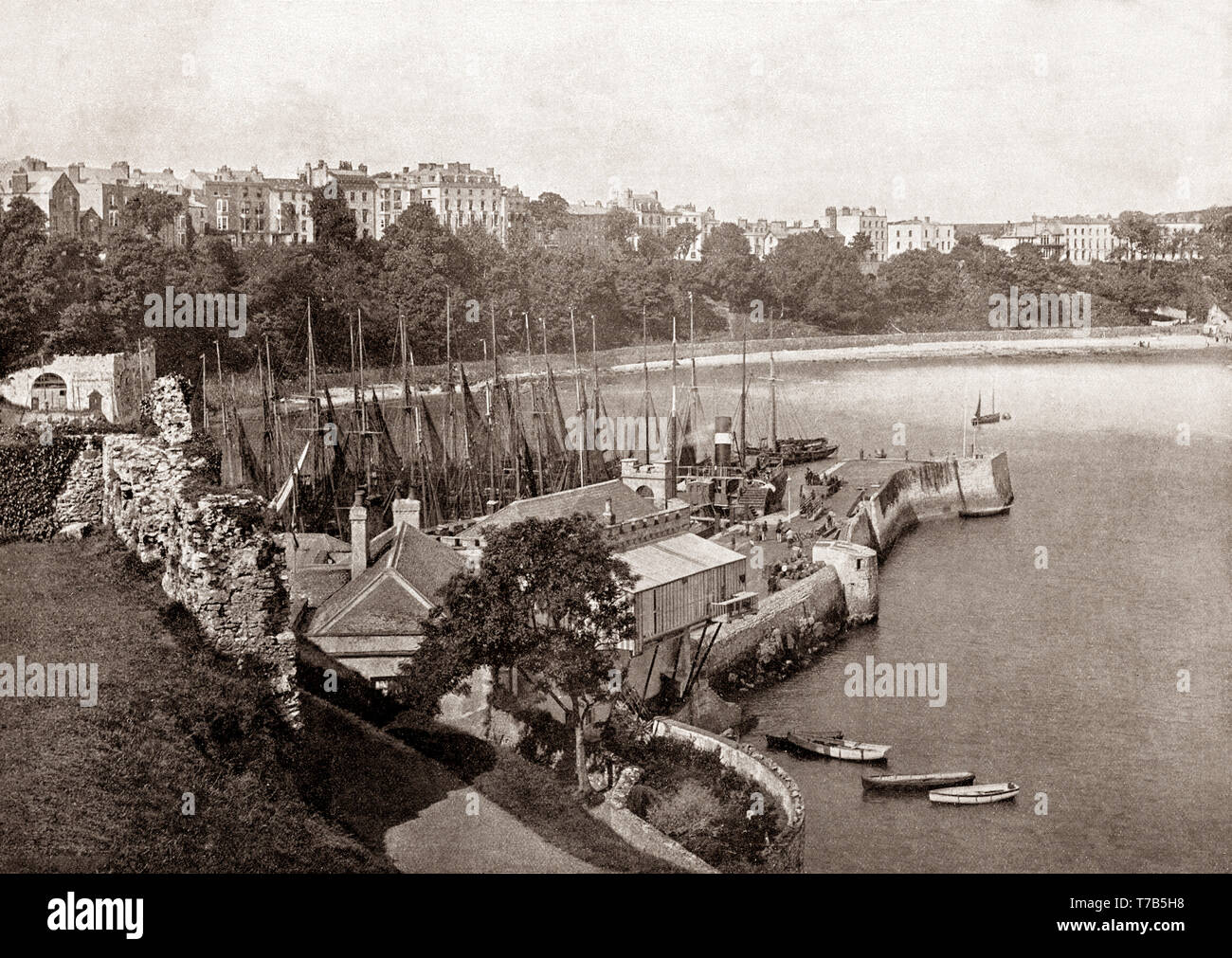 A late 19th Century view of Tenby, a walled seaside town in Pembrokeshire, Wales, on the western side of Carmarthen Bay. The town's fortunes rose when a local resident, merchant banker and politician, Sir William Paxton invested heavily in the area. With the growth in saltwater sea-bathing for health purposes, Paxton went on to create a 'fashionable bathing establishment suitable for the highest society. - Stock Image