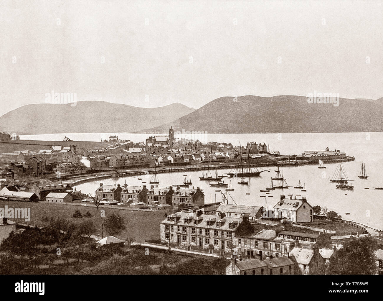 A late 19th Century view of the sheltered bay of Gourock, a town on the East shore of the upper Firth of Clyde in the Inverclyde council area in the West of Scotland. Like many Scottish seaside towns, Gourock's tourist heyday was in the latter half of the nineteenth century and the first half of the twentieth. - Stock Image