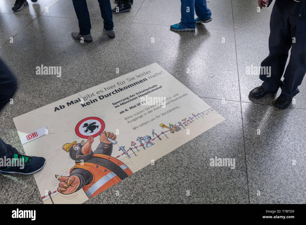 Munich, Germany. 06th May, 2019. A poster with the inscription 'From May on there is unfortunately no getting through for you here anymore' is stuck on the floor of the counter hall in the Bavarian state capital, which is to be closed for public transport at noon and then torn down. The new station building will be built here by 2029. The operation at the station with long-distance and regional trains as well as suburban and underground trains and trams continues all the time. Credit: Peter Kneffel/dpa/Alamy Live News - Stock Image