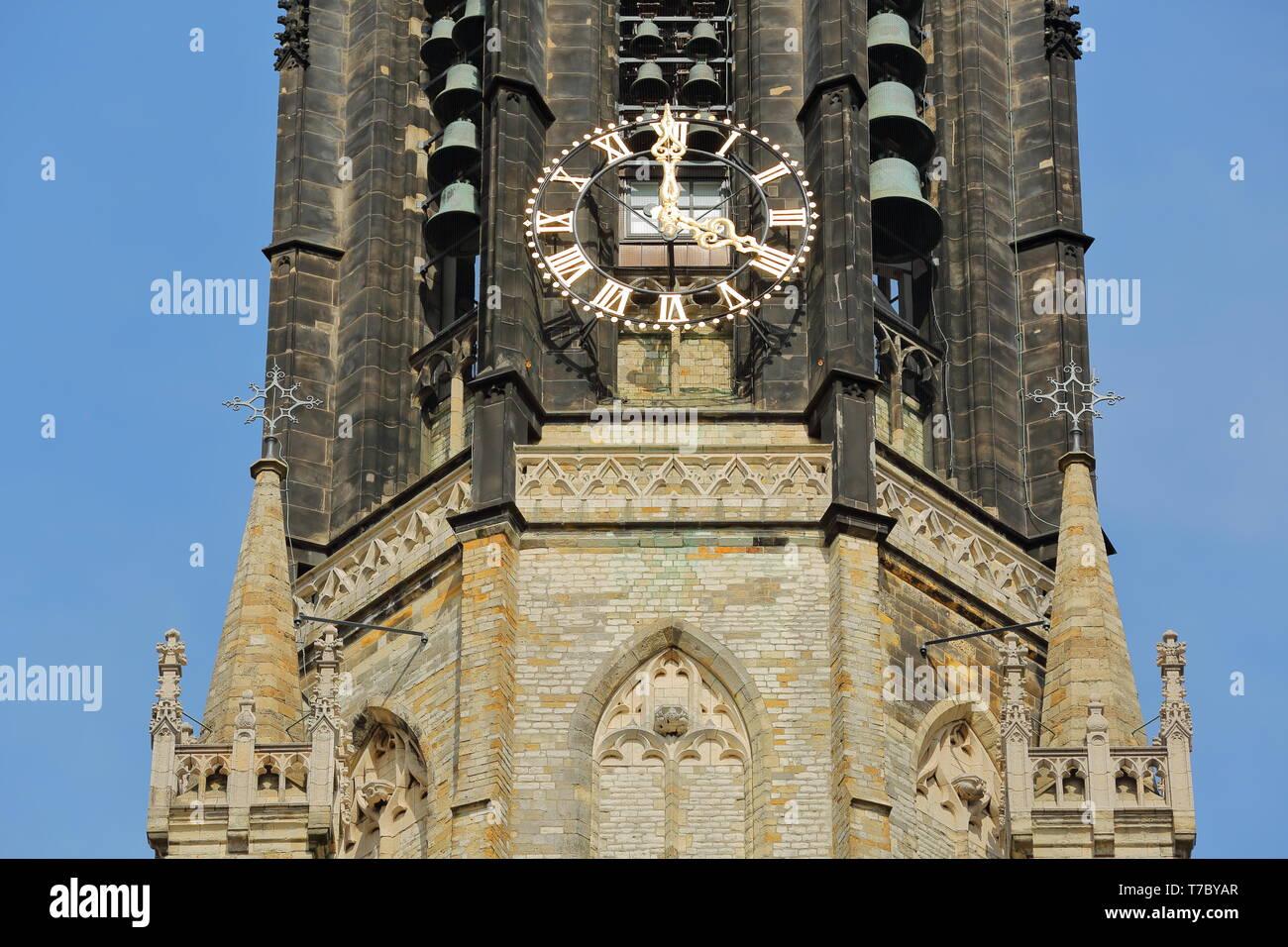 Nieuwe Kerk clock tower: close-up on clock, bells and spires, Delft, Netherlands Stock Photo