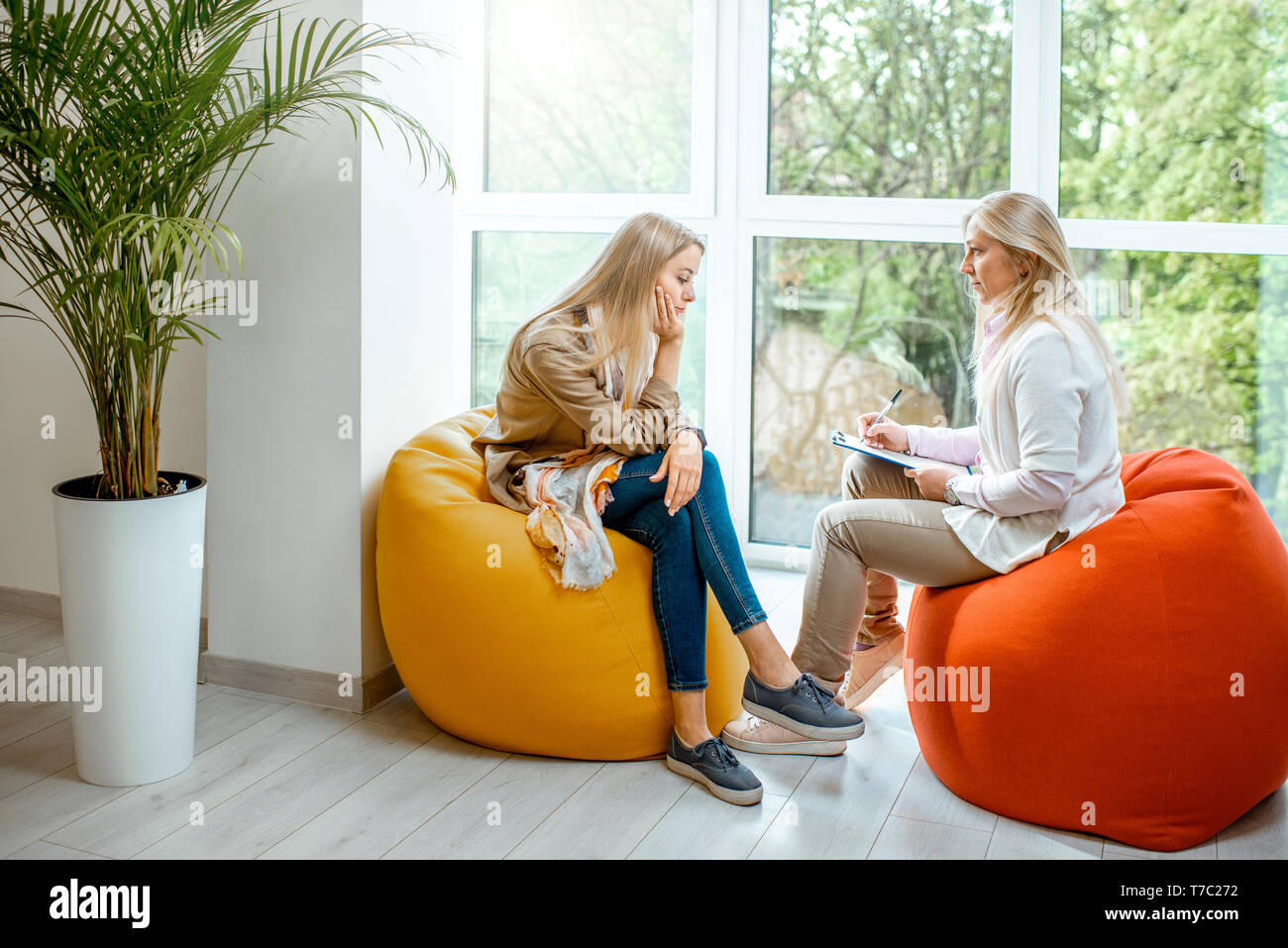 Young Woman With Senior Female Psychologist Or Mental Coach