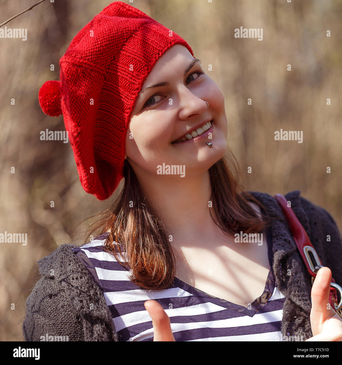 a2948bb1a0958 Outdoor close up portrait of young beautiful happy smiling girl wearing  french style red knitted beret