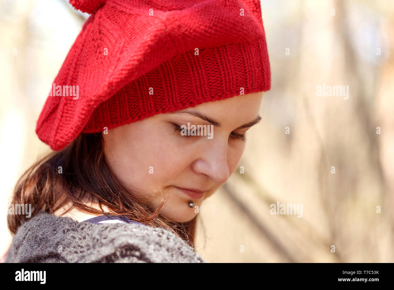 80c02a44 Outdoor close up portrait of young beautiful happy smiling girl wearing  french style red knitted beret