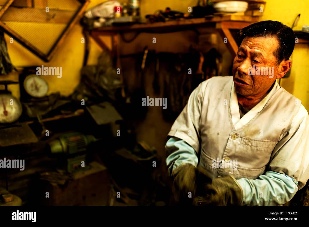 an old blacksmith in the Korean Folks Village, Yangin, Seoul,South