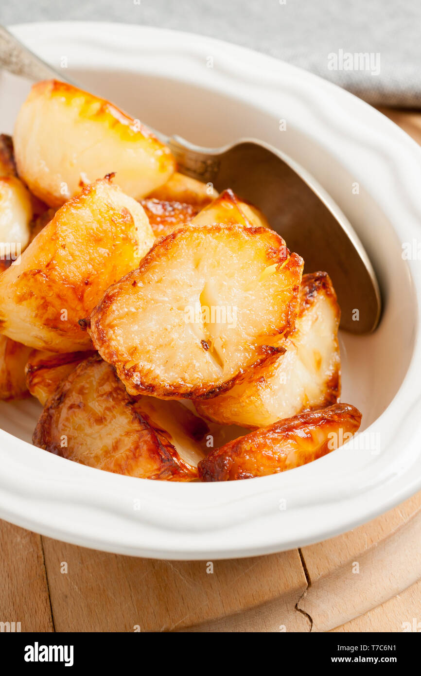 Home made roast potatoes oven cooked in beef fat until crisp and golden a favourite side dish with Sunday dinners - Stock Image