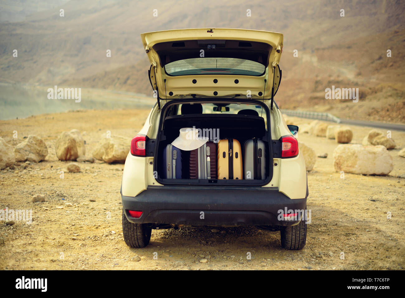 Suitcases and bags in car trunk. Summer holidays. Travel, adventure concept - Stock Image
