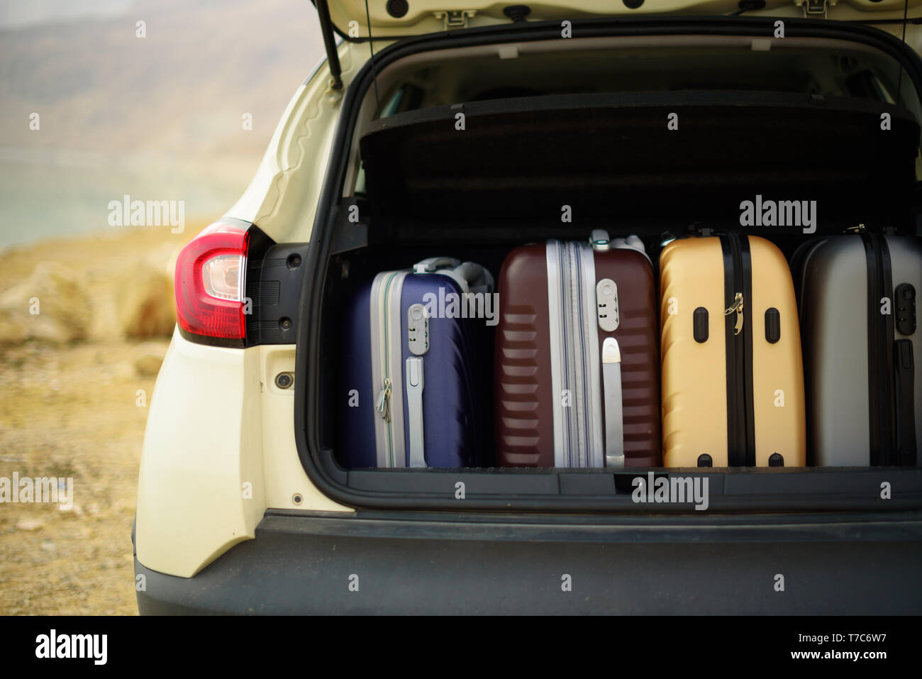 Opened car trunk full of suitcases, luggage, baggage. Summer holidays, travel, trip, adventure concept - Stock Image