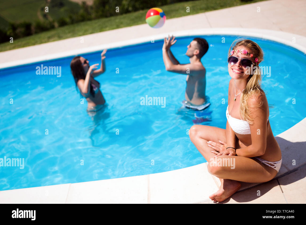 Friends playing ball games in pool Stock Photo: 245519120 - Alamy