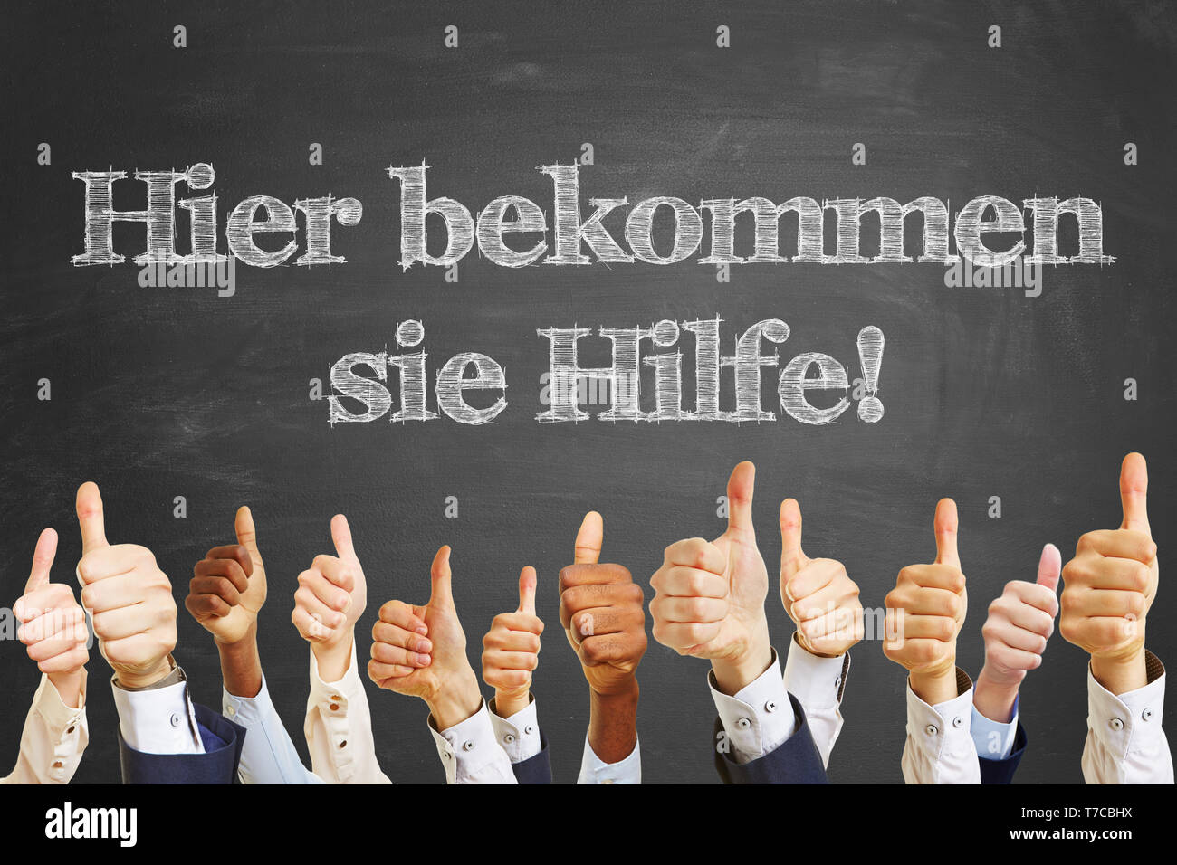 Blackboard with German slogan 'Hier bekommen sie Hilfe!' (Here you will get help!) - Stock Image