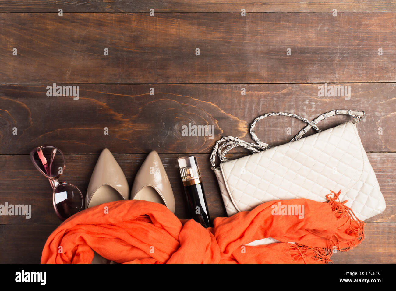 Woman accessories for bussiness with copy space over wooden table - Stock Image