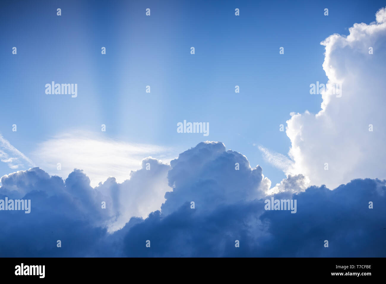 Cloudscape and dramatic blue sky, sunset shot - Stock Image