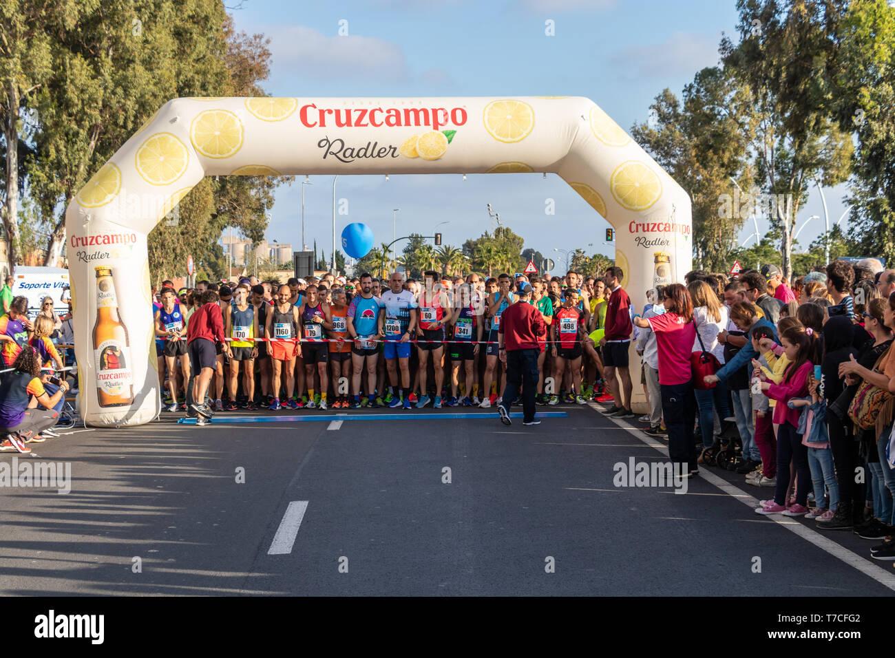 Huelva, Spain - May 4, 2019:  Runners at the start of the Huelva solidary 10K Run on May 2019. The first 10K race held in Huelva - Stock Image