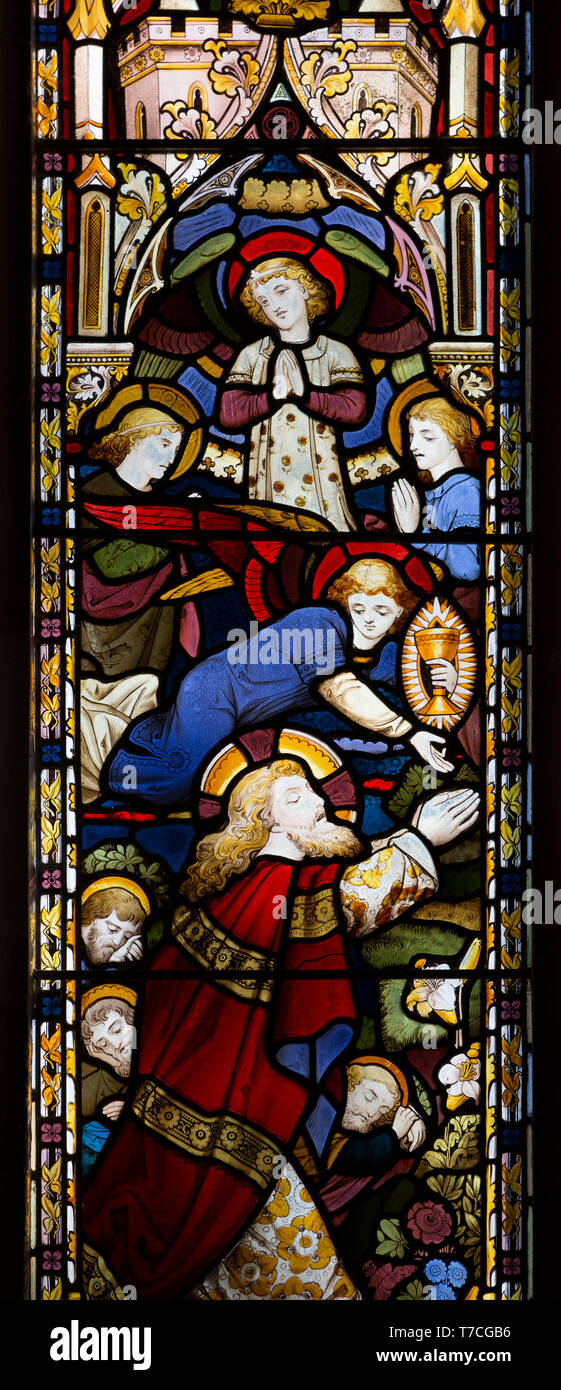 Stained glass window in church of Saint John the Baptist, Badingham, Suffolk, England, UK circa 1875 by Cox and Son, Jesus Christ in garden of Gethsem - Stock Image