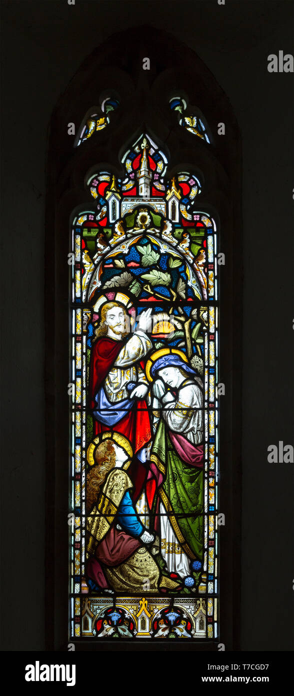 Stained glass window in church of Saint John the Baptist, Badingham, Suffolk, England, UK circa 1875 by Cox and Son, Jesus Christ with two women - Stock Image