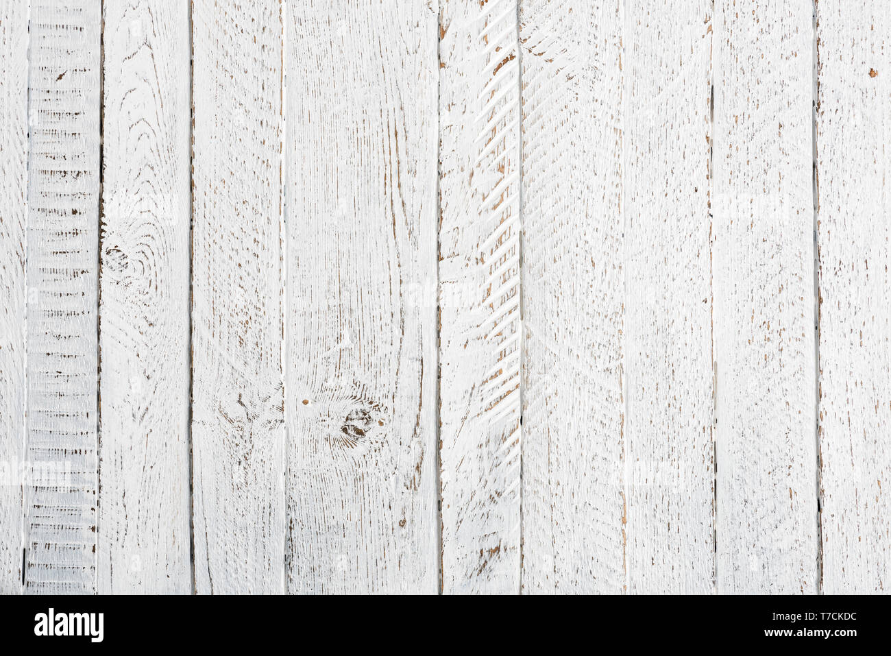 Old wooden table texture white painted and worn top view - Stock Image