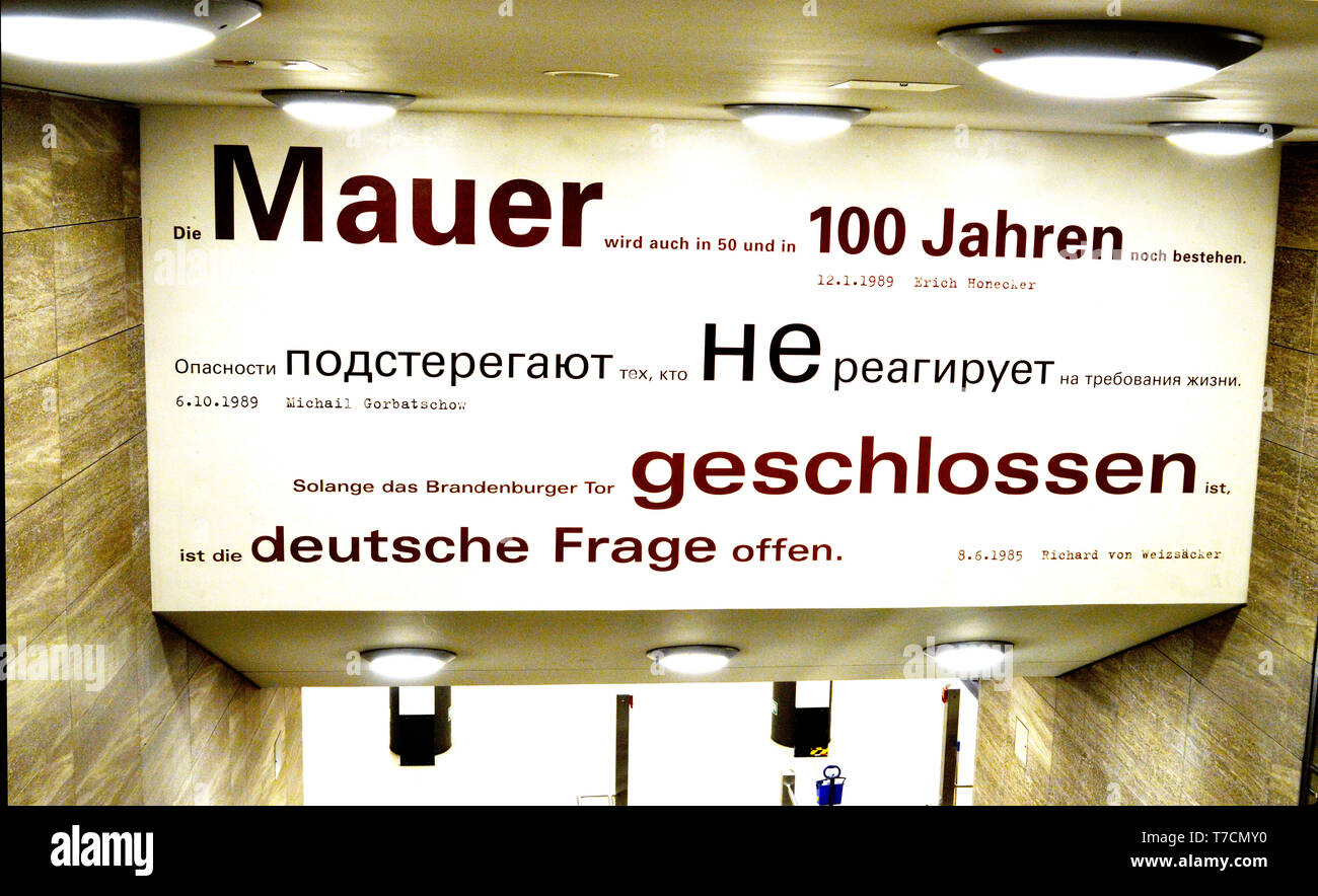 BERLIN, GERMANY - 2 APRIL 2019: Quotations about the Berlin Wall displayed at the Brandenburg Gate Underground Station beginning with Honecker in 1989 - Stock Image