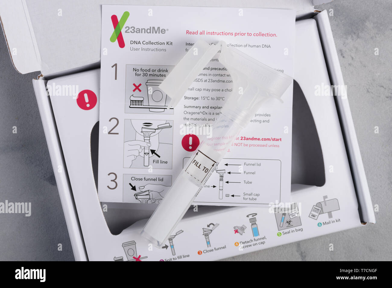 Kiev, Ukraine - 17 October 2018: 23andMe personal ancestry genetic test saliva collection kit, with tube, box and instructions. Illustrative editorial - Stock Image