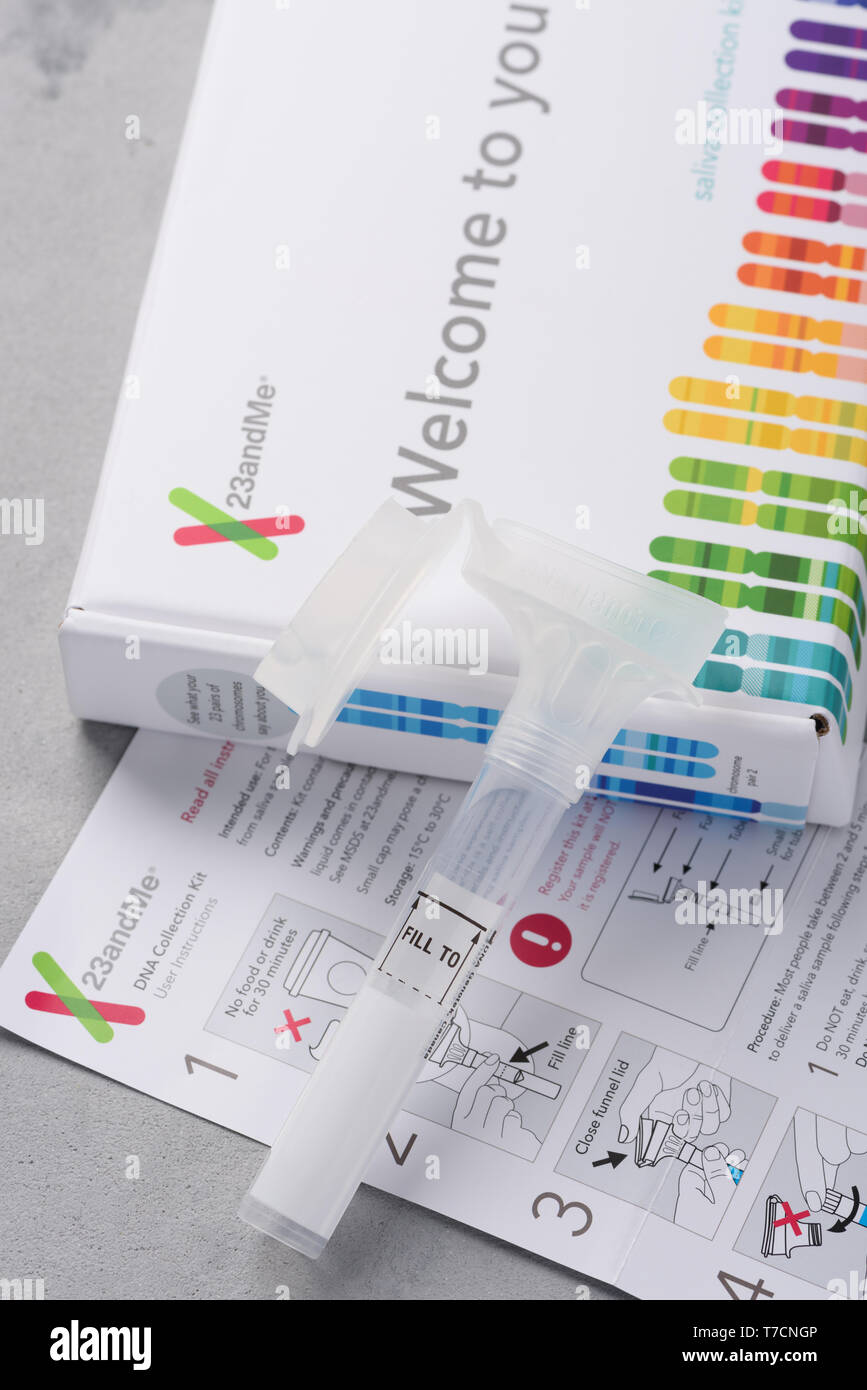 Kiev, Ukraine - 17 October 2018: 23andMe new personal ancestry genetic test saliva collection kit, tube, box and instructions. Illustrative editorial. - Stock Image