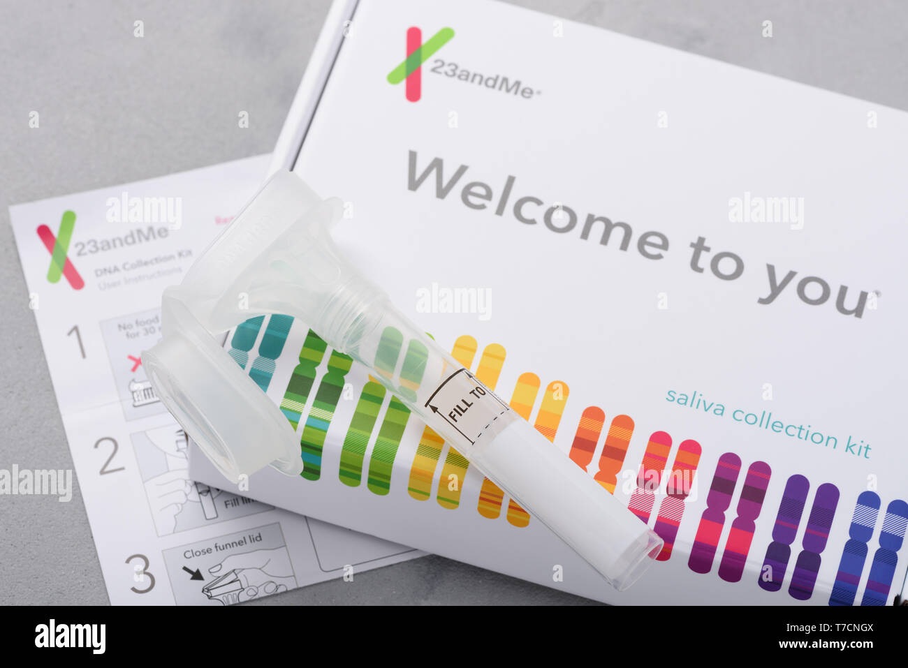 Kiev, Ukraine - 17 October 2018: 23andMe personal genetic test saliva collection kit, with tube, box and instructions. Illustrative editorial. - Stock Image