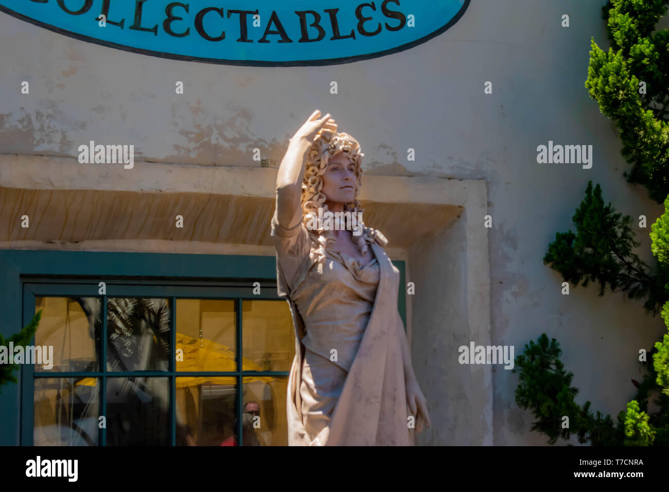 Orlando, Florida. April 20, 2019. Woman living statue throws small jets of water from her hands at Seaworld in International Drive area (4) - Stock Image