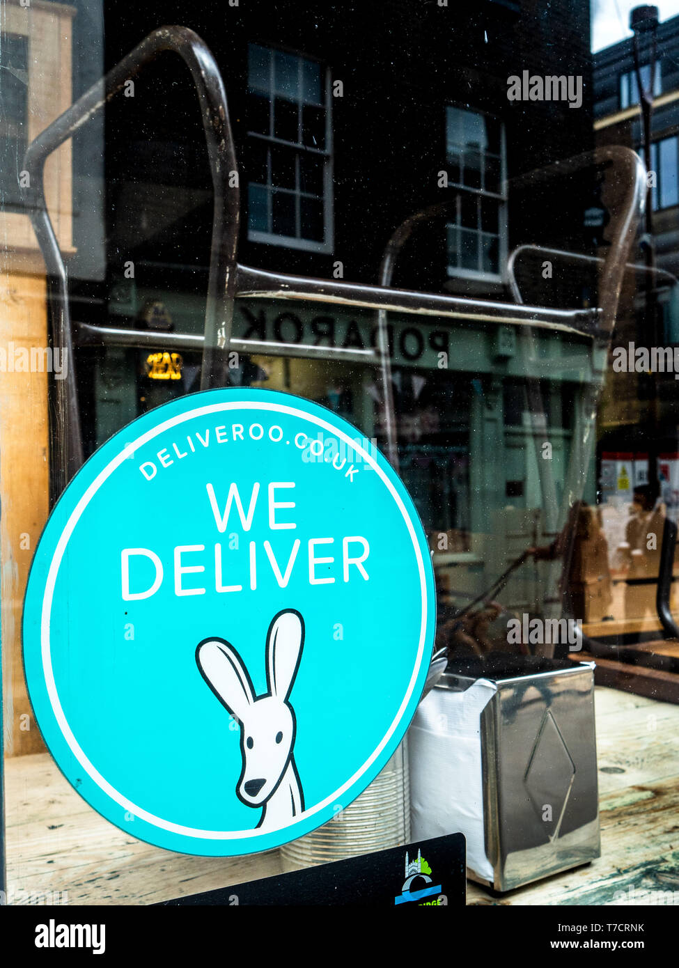 Deliveroo We Deliver sticker in the window of a restaurant in Cambridge UK - Stock Image
