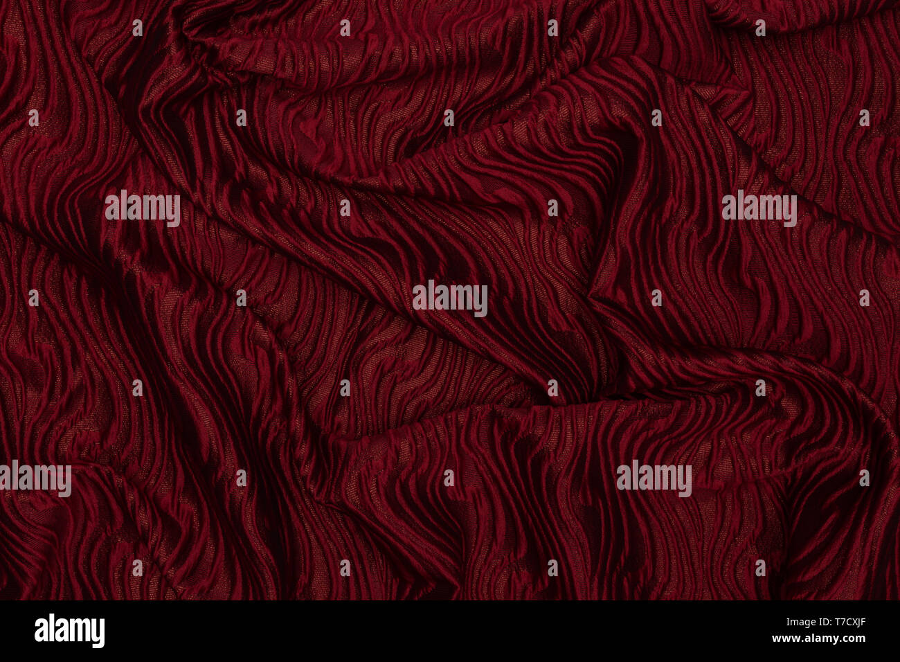 Elegant Red Shiny Fabric With Corrugated Fabric Texture Stock Photo