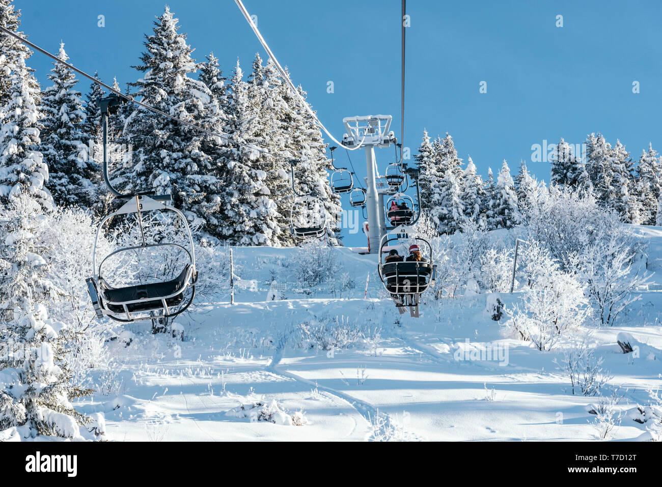 La Clusaz (eastern France): chairlifts above the ski slopes of the ski resort Stock Photo