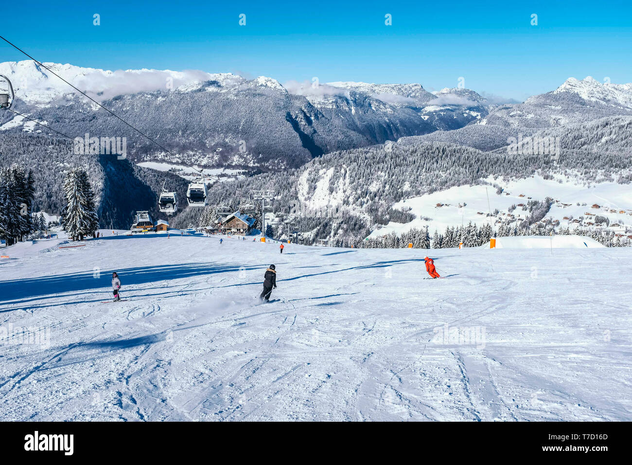 La Clusaz (eastern France): the village covered in snow viewed from the upper ski runs of the ski resort - Stock Image