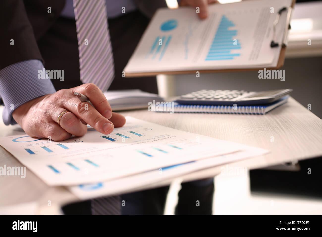 Accountant Calculate Tax Invoice Using Calculator - Stock Image