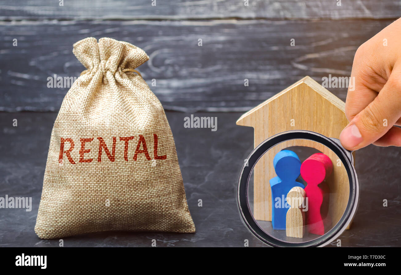 A bag with money and the word Rental and a family standing near the house. The accumulation of money to pay rental housing. Rental apartment. Saving m Stock Photo