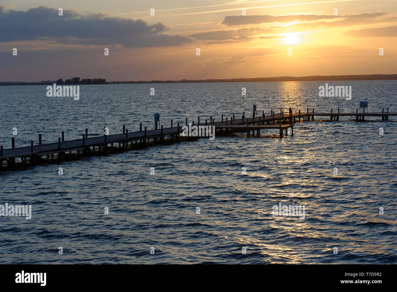 Sunset on the sea and Jetty - Stock Image