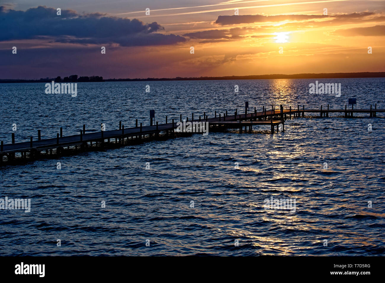 Sunset on the sea and wooden Jetty - Stock Image