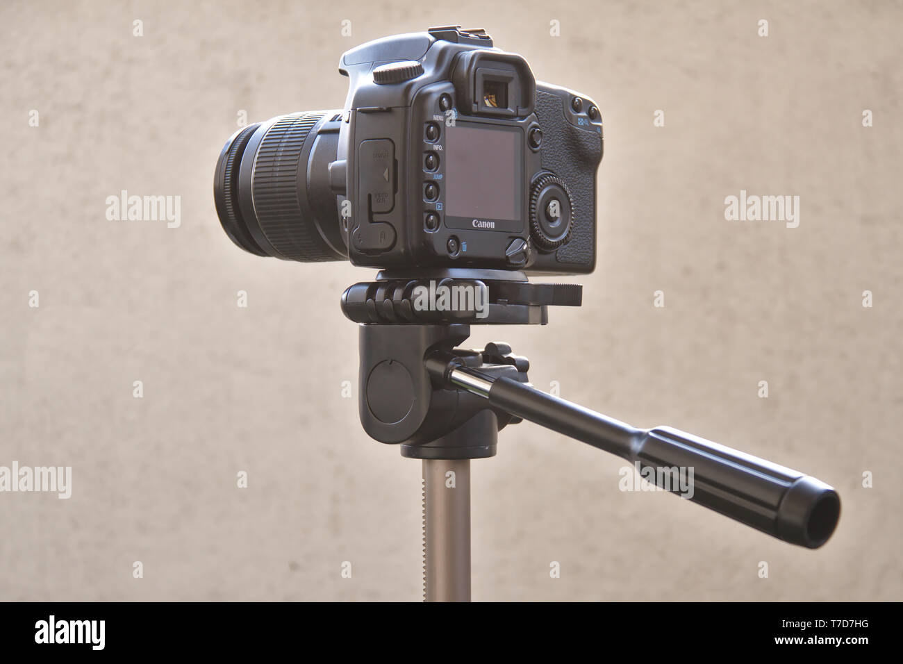 Canon digital camera with lens, attached to the tripod. Photo taken 05/2018 in Espoo, Finland - Stock Image