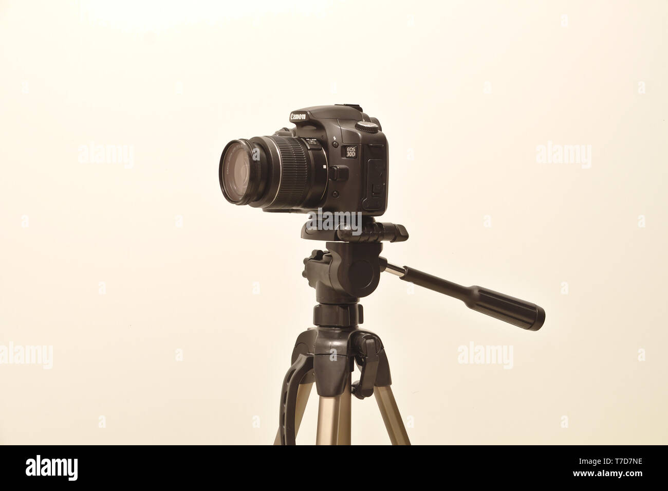Canon 30D digital camera on tripod with Canon EF-S18-55mm lens attached. Photo taken 05/2018 in Espoo, Finland - Stock Image