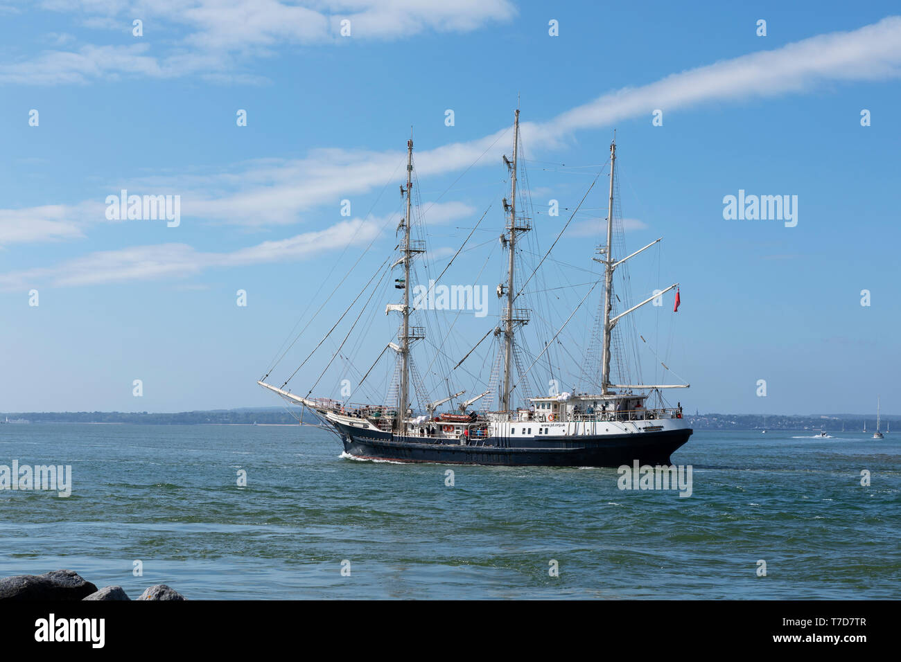 Three masted wooden ship Tenacious leaving Portsmouth harbour. A social inclusion ship for able bodied and disabled alike. - Stock Image