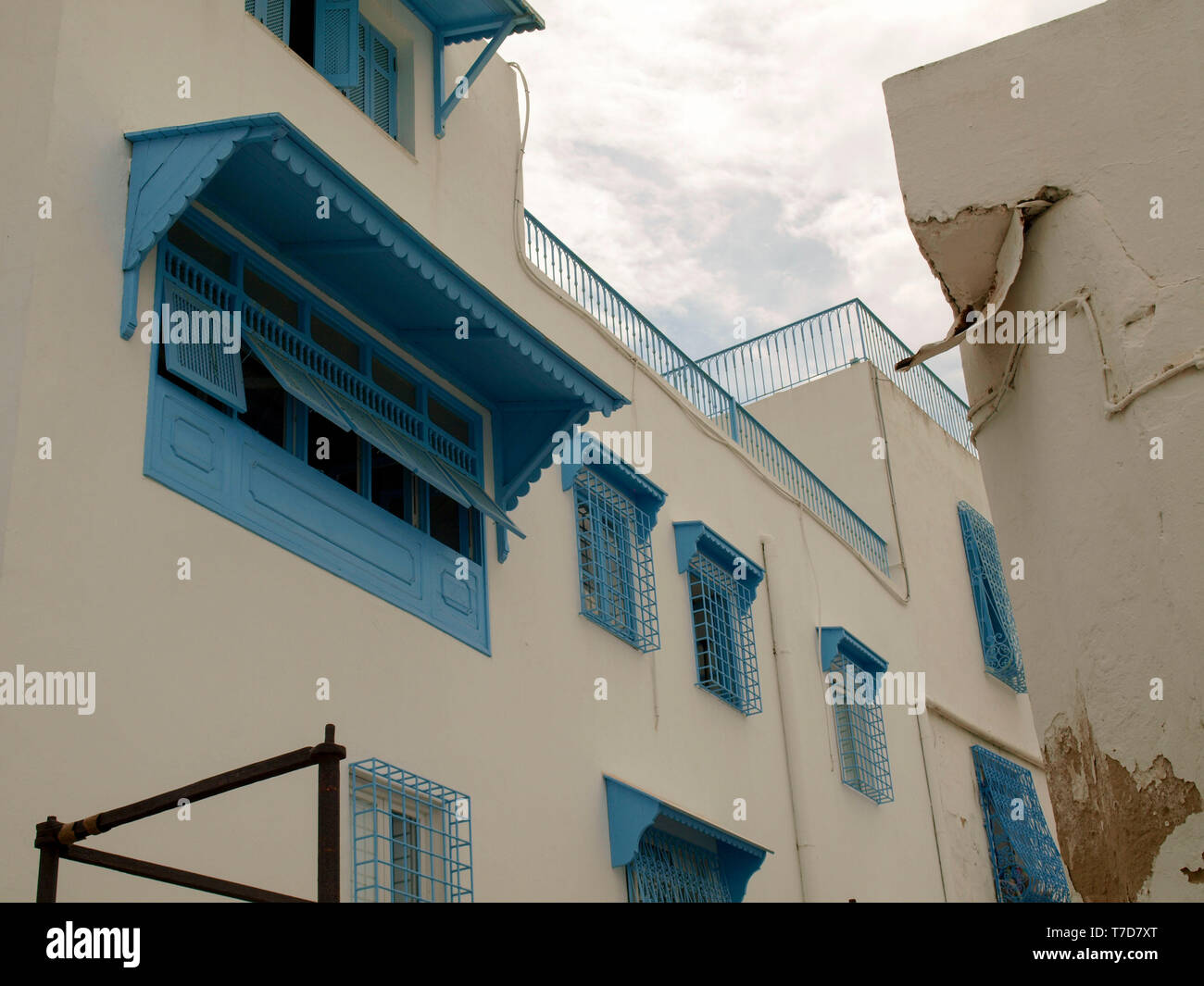 Windows and buildings close to the center of Sidi Bou Said, the famous village with traditional Tunisian architecture Stock Photo