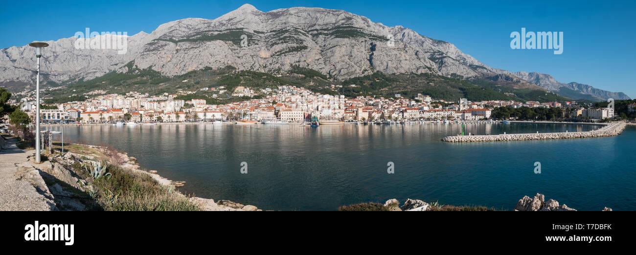 Makarska city panorama from the sea on sunny summer day - Stock Image