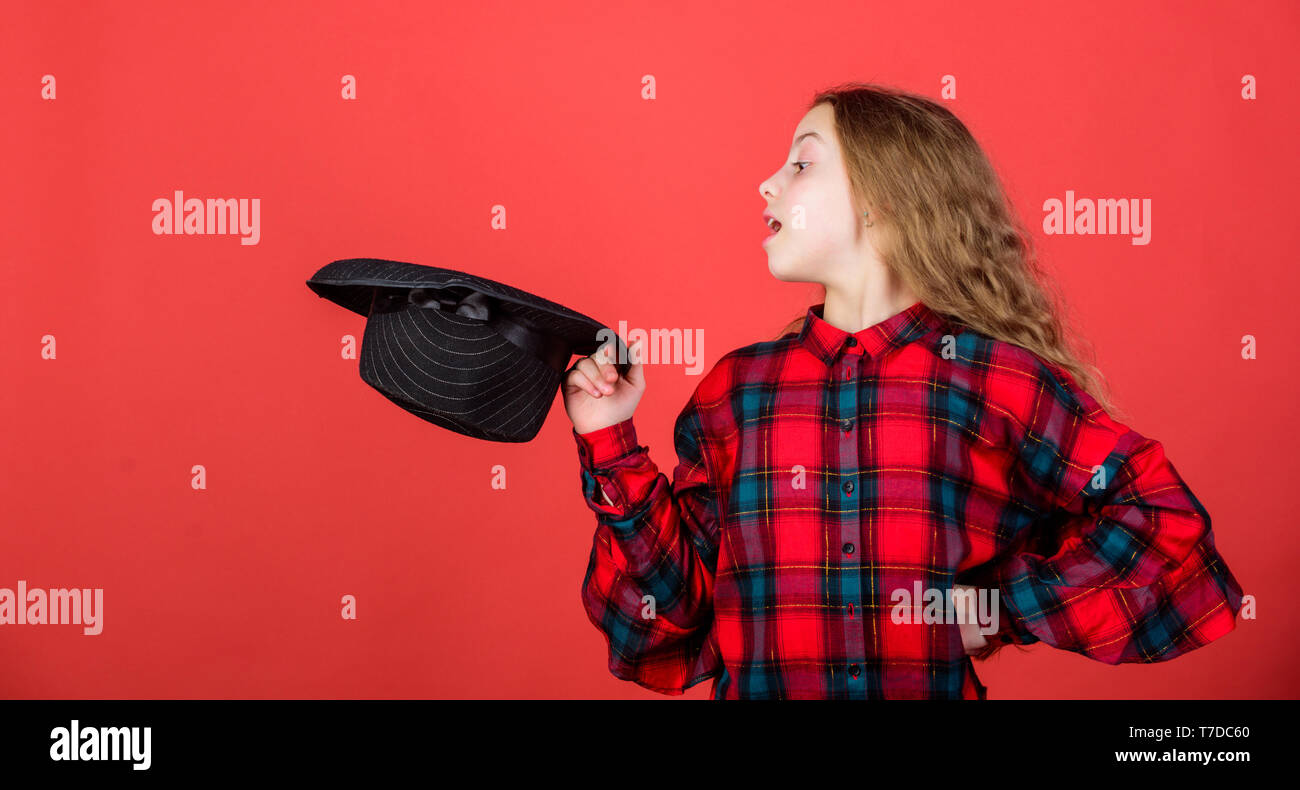 Enter acting academy. Acting school for children. Acting lessons guide children through wide variety of genres. Develop talent into career. Girl artistic kid practicing acting skills with black hat. - Stock Image