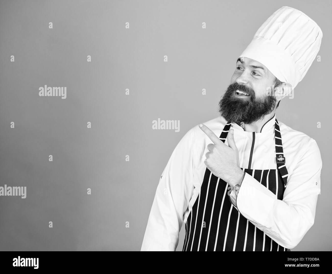 He is a champion in the kitchen. Perfect chef with neat look. Professional chef in cook uniform. Happy bearded man in apron. copy space. restaurant cuisine. Culinary expert. best chef ever. - Stock Image