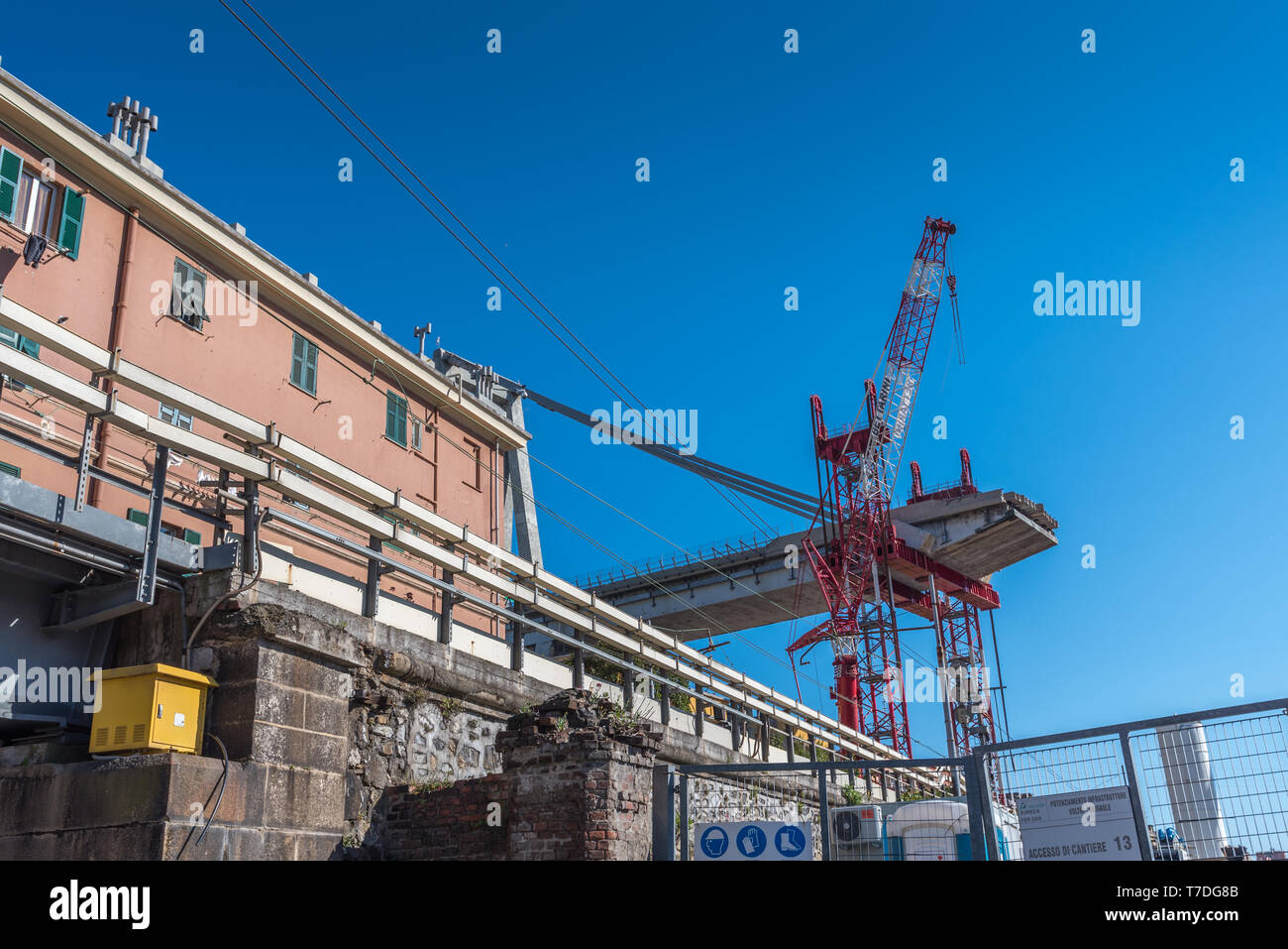 Genoa, Genova, Italy: Demolition work, dismantling works to disassemble what is left of partially collapsed Morandi bridge (Polcevera viaduct) - Stock Image
