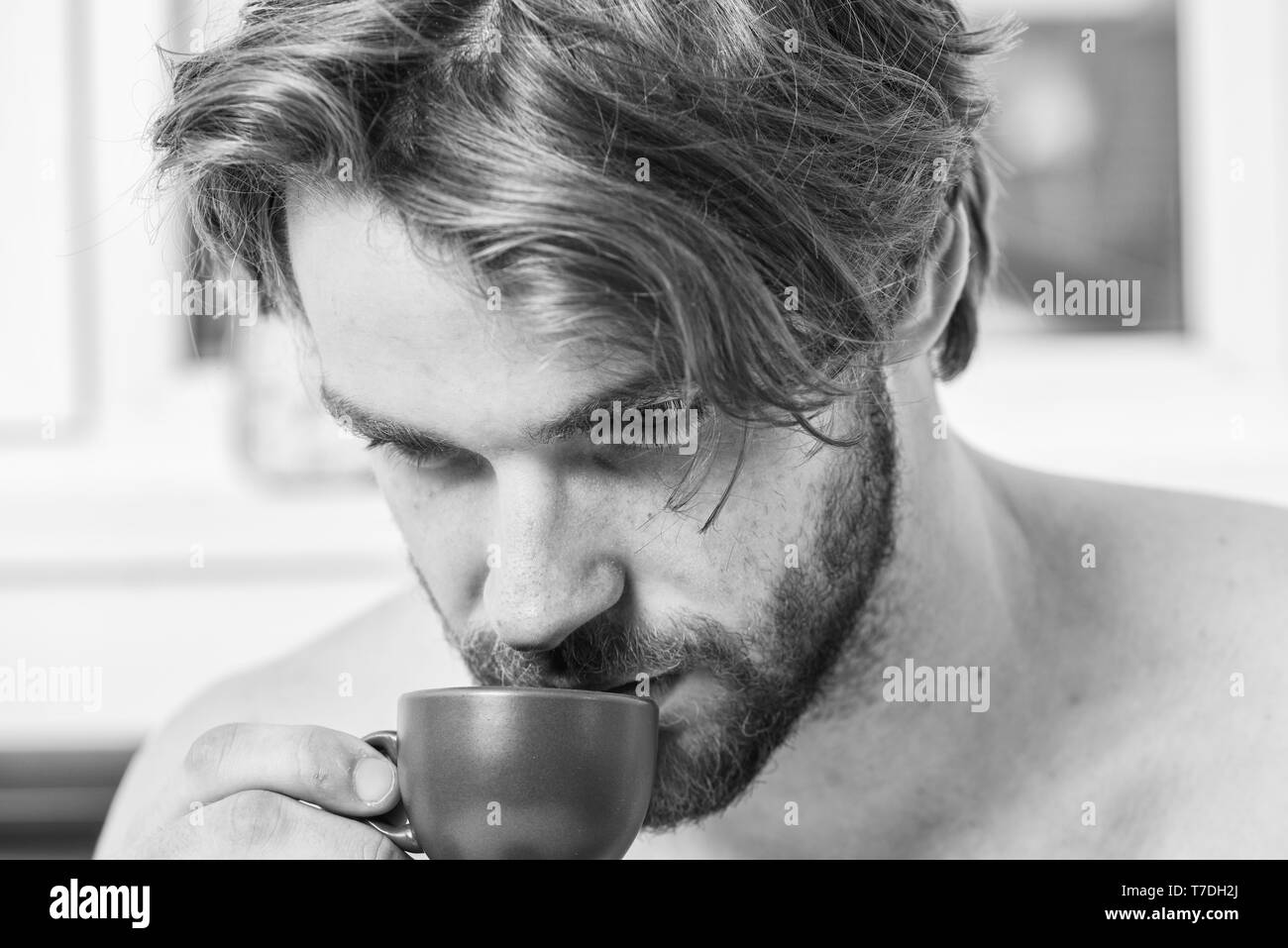 First sip. Every morning with his coffee. Man bearded handsome macho hold cup of coffee. Best time to have your cup of coffee. Guy attractive appearance man enjoy hot fresh brewed coffee close up. - Stock Image