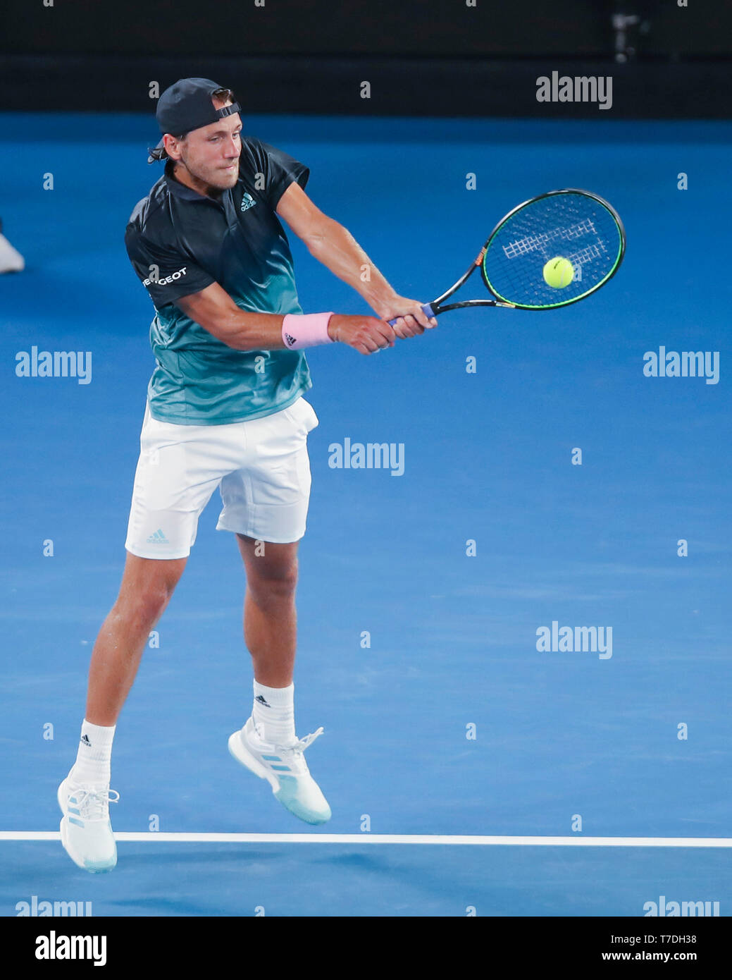 French tennis player Lucas Pouille playing backhand shot in Australian Open 2019 tennis tournament, Melbourne Park, Melbourne, Victoria, Australia - Stock Image