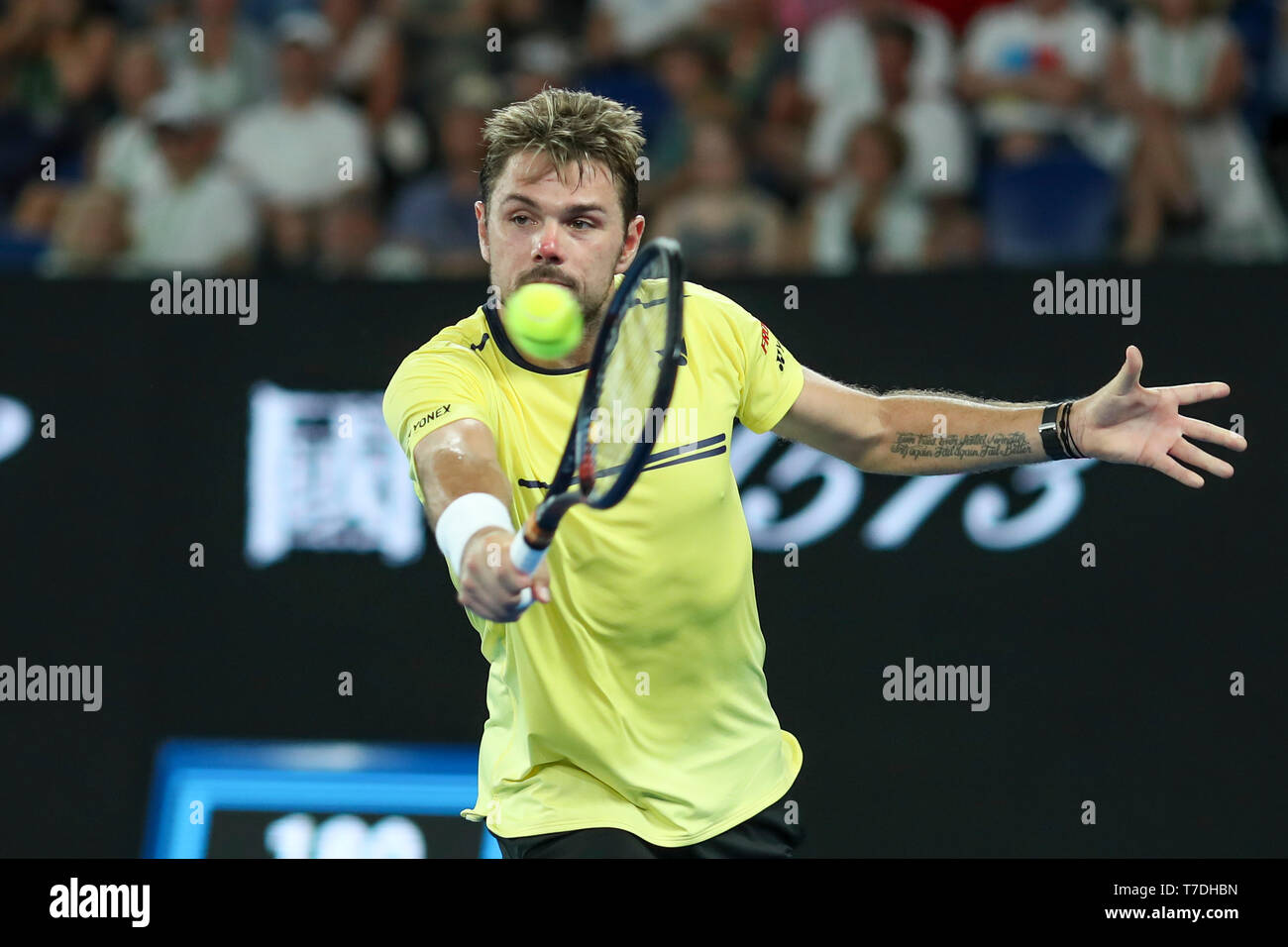 Swiss tennis player Stan Wawrinka playing backhand shot in Australian Open 2019 tennis tournament, Melbourne Park, Melbourne, Victoria, Australia - Stock Image