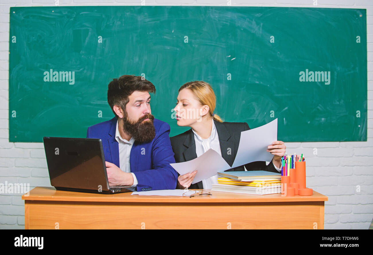School educator with laptop and principal with documents. Educational program. School education. Prepare for school lesson. Annual report. Teacher and supervisor working together in school classroom. - Stock Image