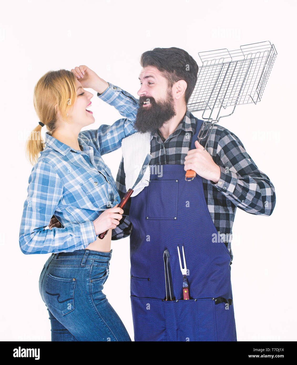 Family barbeque. Family weekend. Picnic barbecue. food cooking recipe. Tools for roasting meat. Couple in love hold kitchen utensils. Man bearded hipster and girl. Preparation and culinary. - Stock Image