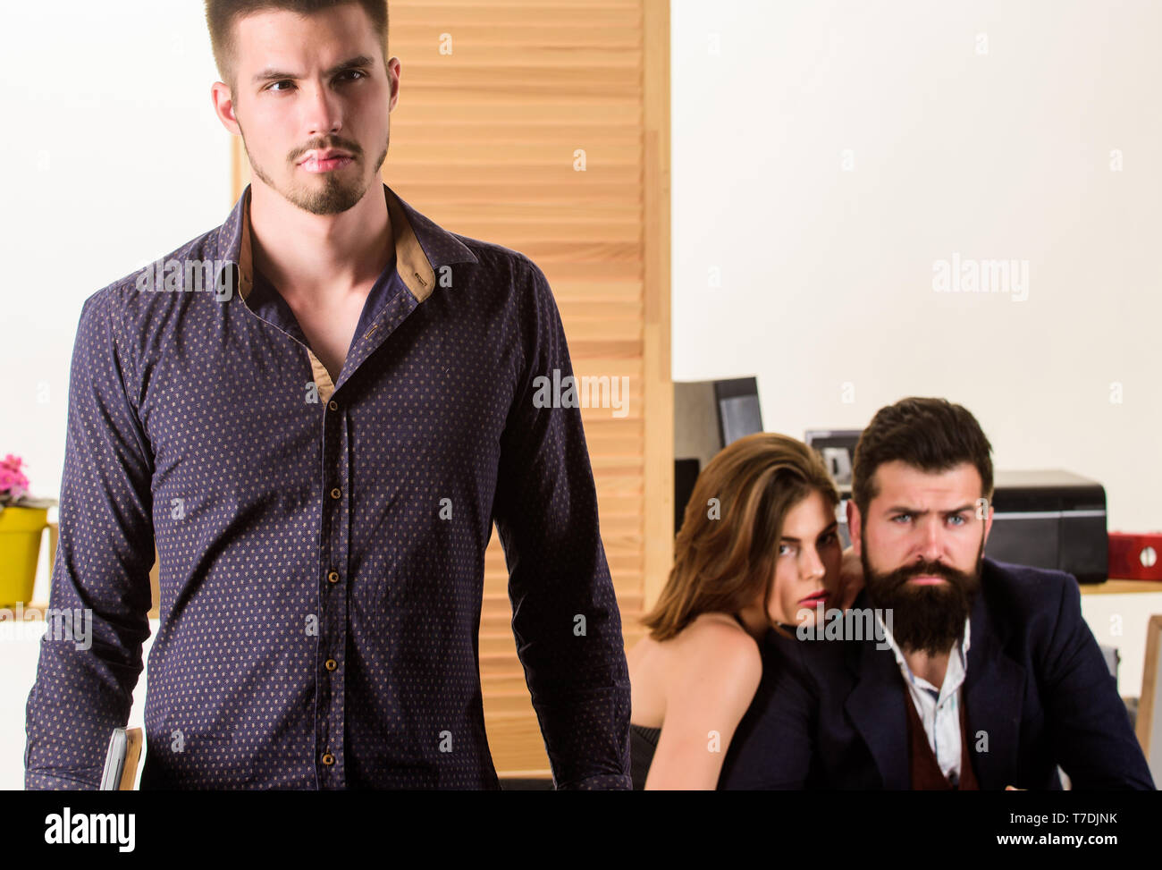 Being successful does not just happen. Successful businessman. Successful small business owner standing infront of collegues in contemporary office. Successful young employee working in office. - Stock Image