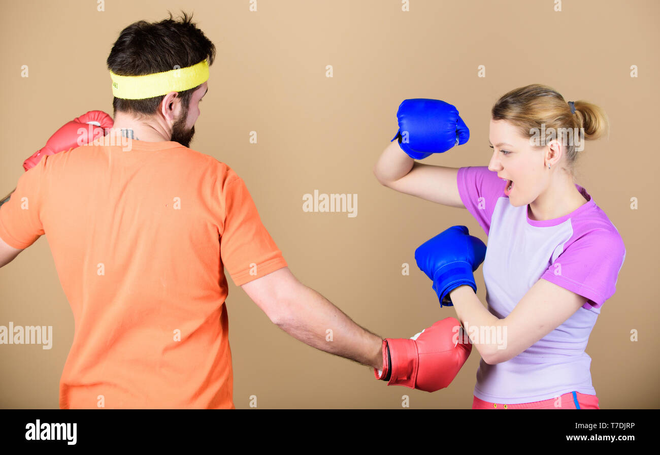 Defense wins championships. punching, sport Success. sportswear. Fight. Happy woman and bearded man workout in gym. training with coach. knockout and energy. couple training in boxing gloves. - Stock Image