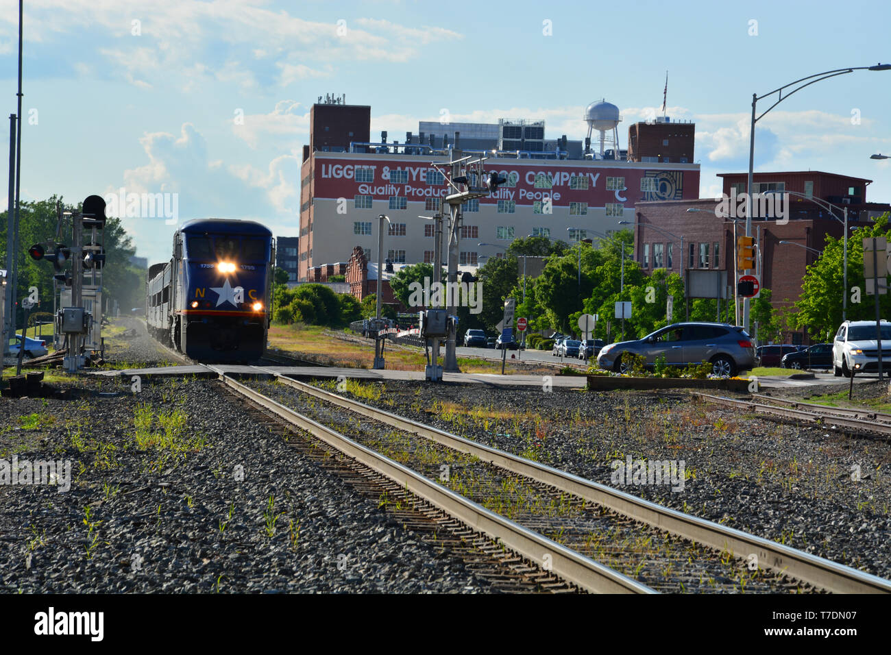 The Amtrak train Piedmont pulls out of the station in downtown Durham North Carolina on its way to Raleigh. - Stock Image