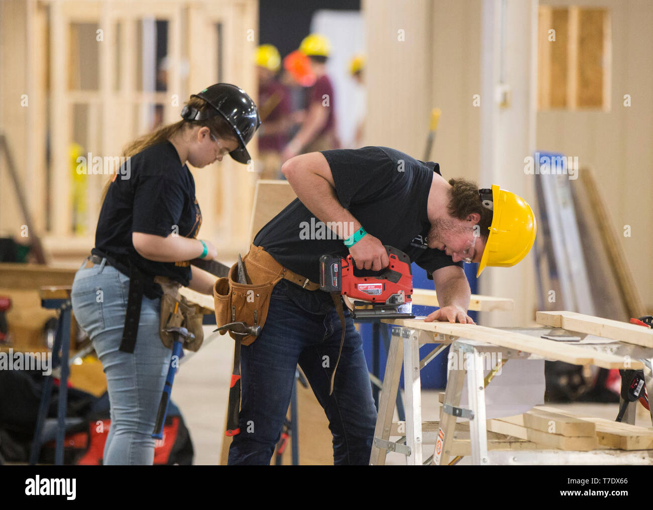 Toronto, Canada. 6th May, 2019. Students compete during the home building sector of the 2019 Skills Ontario Competition in Toronto, Canada, on May 6, 2019. The 2019 Skills Ontario Competition kicked off here on Monday, attracting more than 2,400 competitors. A broad range of skills and careers are represented at the three-day competition from across the manufacturing, transportation, construction, service, and technology sectors. Credit: Zou Zheng/Xinhua/Alamy Live News - Stock Image