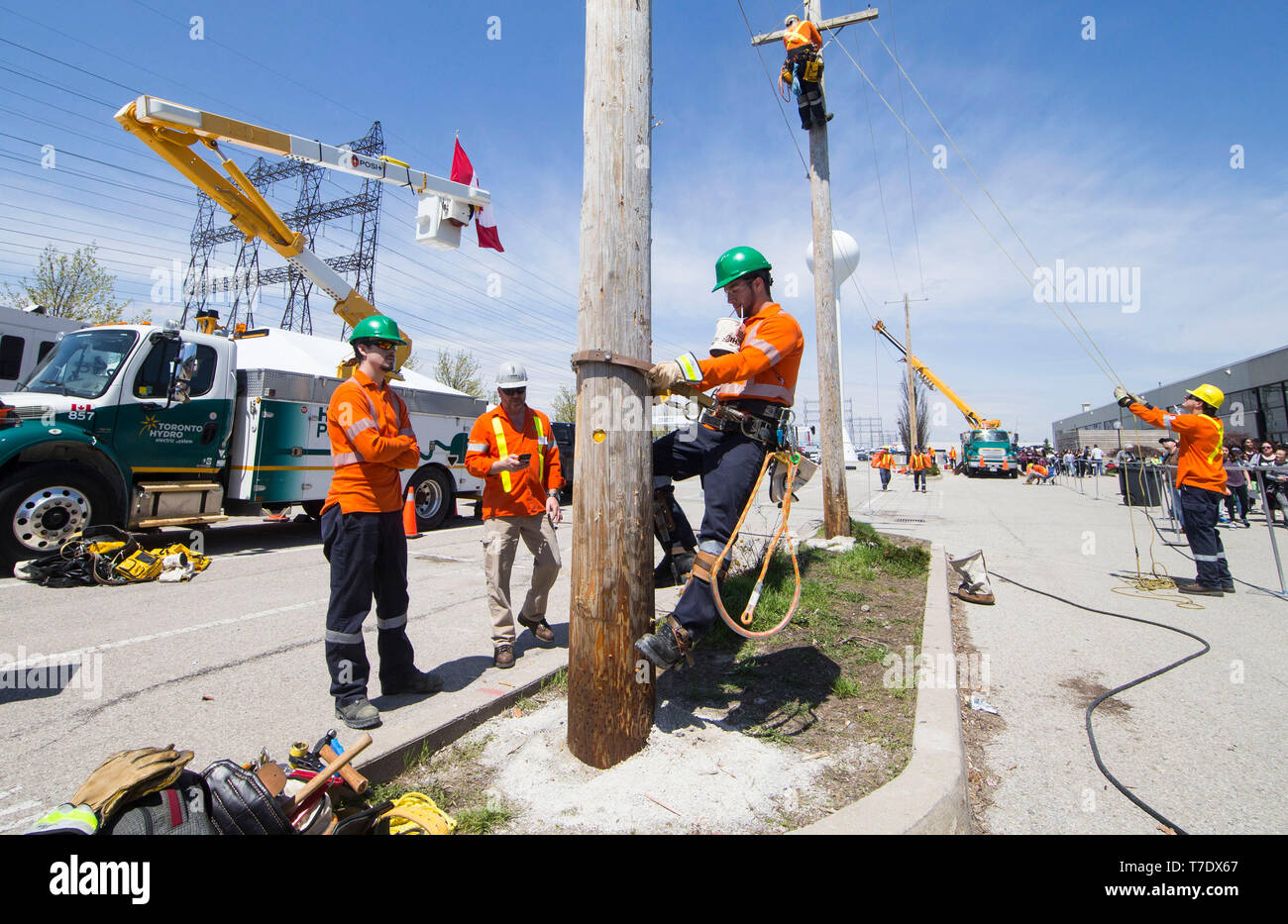 Toronto, Canada. 6th May, 2019. A student (C) competes during the power line technician sector of the 2019 Skills Ontario Competition in Toronto, Canada, on May 6, 2019. The 2019 Skills Ontario Competition kicked off here on Monday, attracting more than 2,400 competitors. A broad range of skills and careers are represented at the three-day competition from across the manufacturing, transportation, construction, service, and technology sectors. Credit: Zou Zheng/Xinhua/Alamy Live News - Stock Image